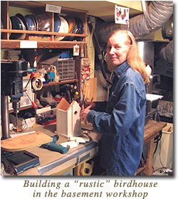Carol builds a rustic style bird house in her basement workshop